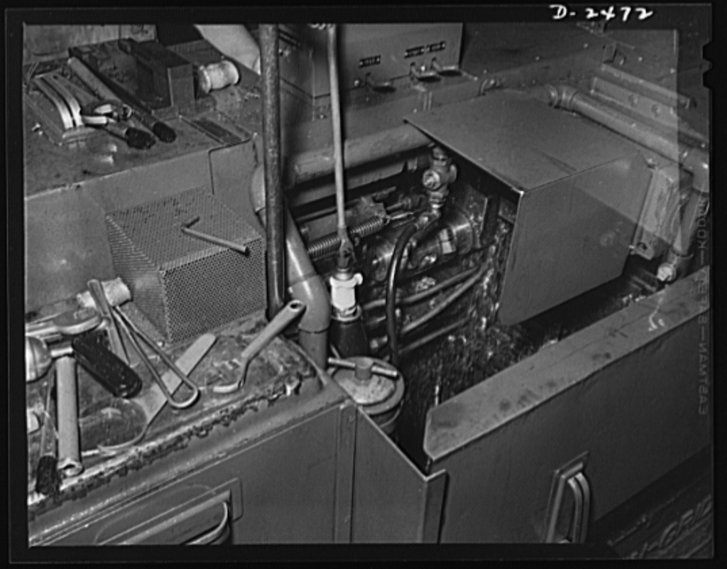 Two new tools were set in the New Britain-Gridley lathe, pictured above, to adapt it for the cutting of twenty-millimeter shell booster parts. The new parts are an eccentric spindle, which may be seen attached to a driving rod in the center of the machine, and a thread rolling attachment. In peacetime, the machine was used to turn out spur gears, worm wheels and commentator rings in steel and brass