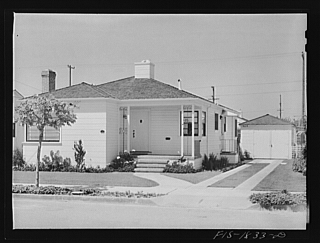 Typical home of San Leandro, California. Notice the block warden sign in the front window. The civilian defense activities have been well organized, and people of Portuguese blood have been quick to volunteer their services