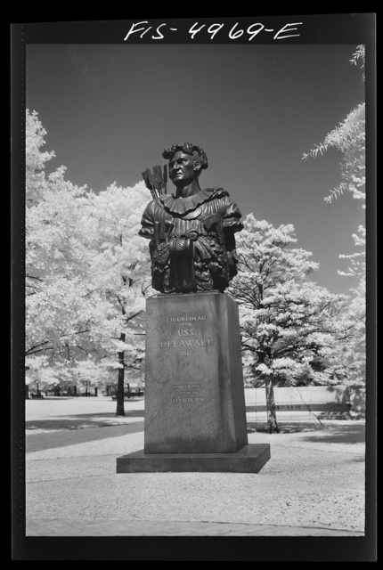"U.S. Naval Academy, Annapolis, Maryland. The ""God of Luck"" bronze replica of the figurehead of the U.S.S. Delaware on the campus of the academy"