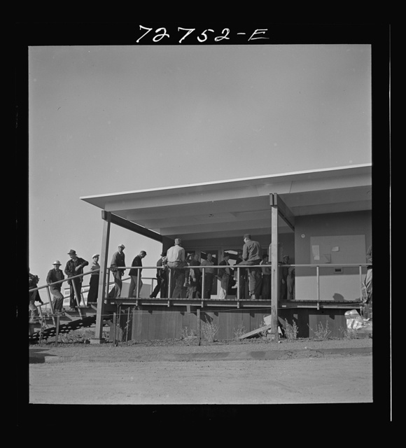 Vallejo, California. Workmen from shipyards at office of FSA (Farm Security Administration) dormitories