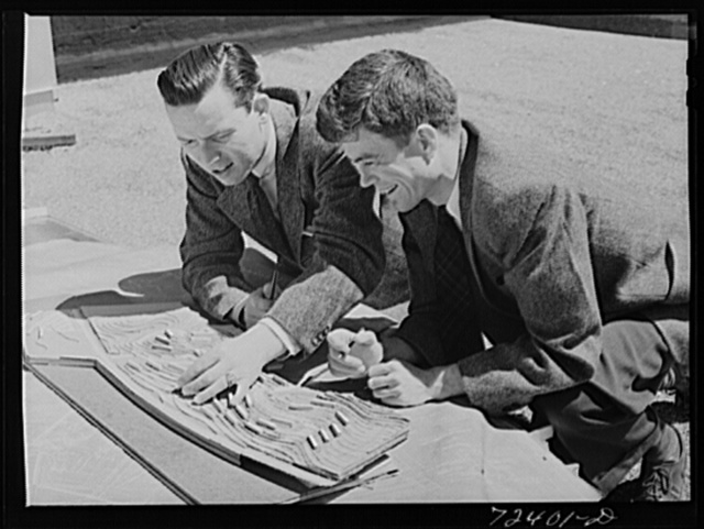 Vernon Demars, left, district landscape architecht for FSA (Farm Security Administration) and Garret Eckbo, district landscape architect for FSA work on site model of the Vallejo, California, defense housing dormitories