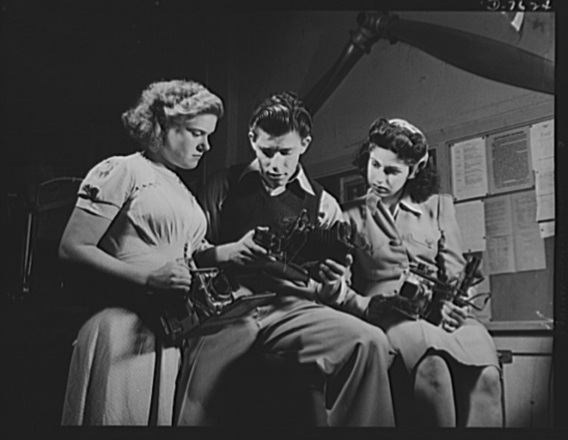 Victory Corps, tomorrow's defenders of liberty. Learning to operate their cameras, these members of the Washington High School Victory Corps in Los Angeles, are being trained for war work. To supply technical training in various skills relating to the war effort is the main object of Victory Corps organizations