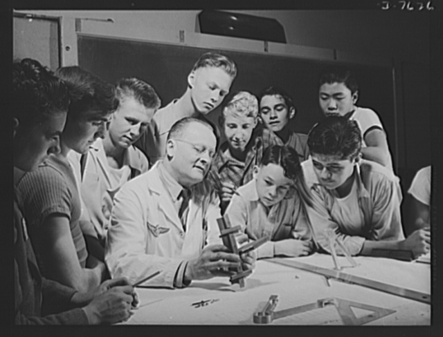 Victory Corps, tomorrow's defenders of liberty. To prepare themselves to build or fly airplanes in the future, Victory Corps members in the airplane engine class at Polytechnic High School in Los Angeles, California, are learning the construction of planes