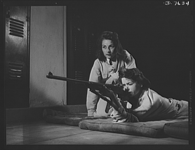 Victory Corps, tomorrow's defenders of liberty. Training in marksmanship helps girls at Roosevelt High School in Los Angeles, California, develop into responsible women. Part of Victory Corps activities there, rifle practice encourages girls to be accurate in handling firearms