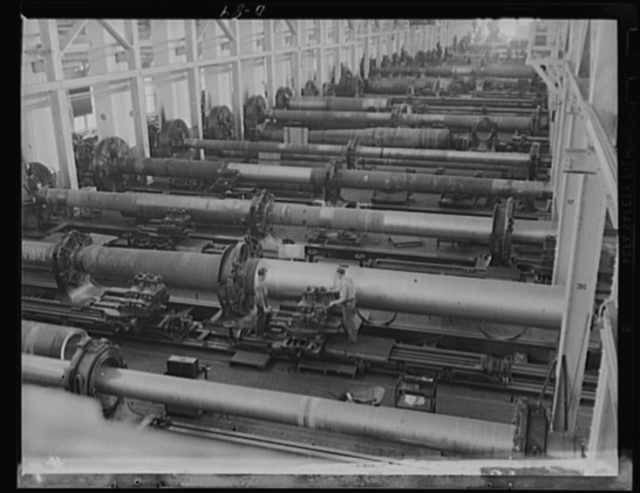 Voices for a mighty argument. A long line of big guns being rushed toward completion under the war production program. Guns shown here are being turned out in the major caliber shop of a large eastern arsenal