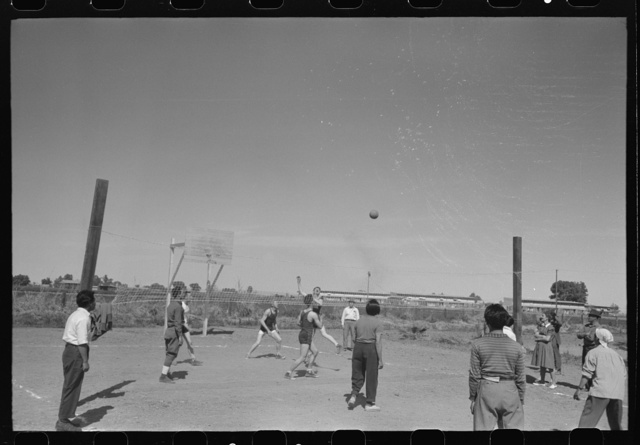 Volleyball game at the annual field day at the FSA (Farm Security Administration) farmworkers community, Yuma, Arizona