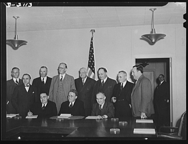 War Labor Board. Here are eleven of the twelve members of the War Labor Board, pictured before their initial meeting on January 16, 1942. Seated are, left to right, vice chairman George W. Taylor, chairman William H. Davis and Frank P. Graham, three of the four public members of the board. The fourth, Wayne L. Morse, was not present. Standing are, left to right, E. J.  McMillan, employers, Matthew J. Woll, labor, Walter C. Teagle, employers, A. W. Hawkes, employers, Roger D. Lapham, employers, three labor members: George Meany, Thomas Kennedy and R.J. Thomas