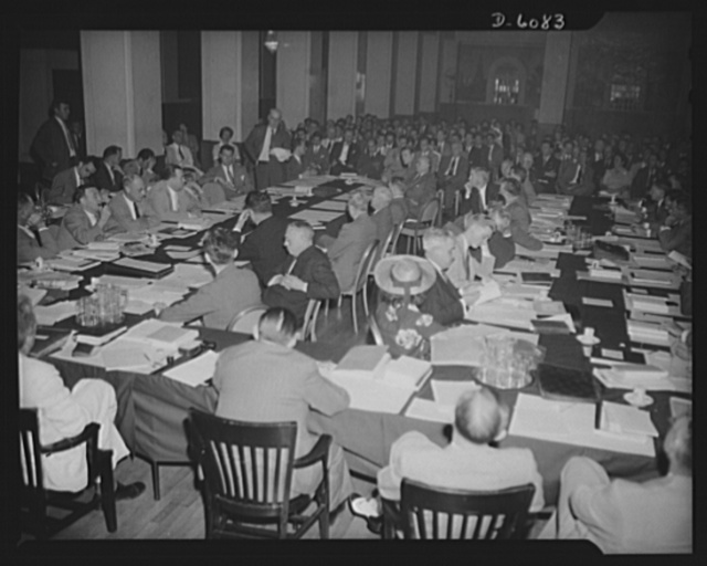 """War Labor Board: """"Little Steel"""" hearing. Philip Murray, Congress of Industrial Organization leader, speaking at the """"Little Steel"""" hearing held by the War Labor Board, at the Hotel Washington in Washington, D.C., July 1. The hearing arose from a wage in Washington, D.C., July 1. The hearing arose from a wage dispute between union demands and four """"Little Steel"""" companies: Bethlehem Steel, Republic Steel, Youngstown Sheet and Tube, and Inland Steel. The hearing resulted in a fifteen per cent wage increase formula, and set a precedent for future wage adjustments to meet recent increases in the cost of living"""