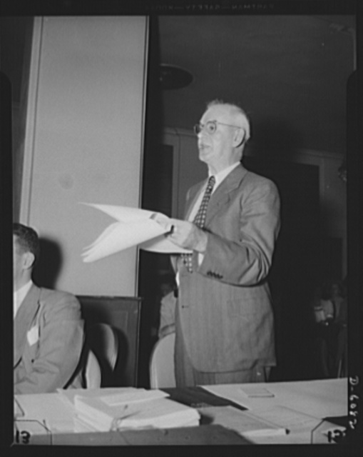 """War Labor Board: """"Little Steel"""" hearing. Philip Murray, Congress of Industrial Organization (CIO) leader, left, and Harold Ruttenberg, research director for United Steel Workers (USW), at the """"Little Steel"""" hearing held by the War Labor Board, at the in Washington, D.C., July 1. The hearing arose from a wage dispute between union demands and four """"Little Steel"""" companies: Bethlehem Steel, Republic Steel, Youngstown Sheet and Tube, and Inland Steel. The hearing resulted in a fifteen per cent wage increase formula, and set a precedent for future wage adjustments to meet recent increases in the cost of living"""