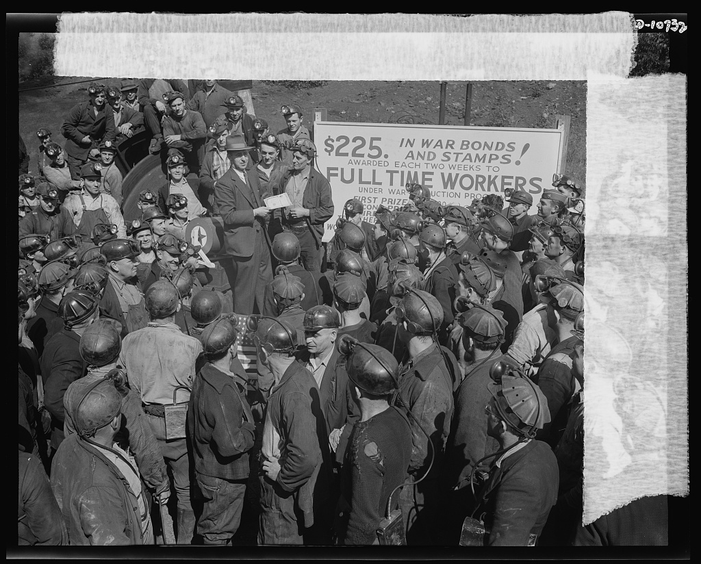 War production drive. Anthracite rallies. A lucky miner who received a 100 dollar war bond at one of the four anthracite miners' rallies in Eastern Pennsylvania on September 28th through October 1st. Only miners with one-hundred-percent work attendance could participate in the drawing
