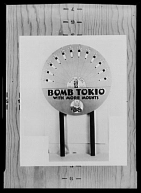 "War production drive. ""Bomb Tokyo with More Mounts."" This unusual display, sponsored by the labor-mangagement committee in the Lamp Division of Westinghouse, was highly effective in the war production drive. As each section increased its production, its bomb was moved nearer the cowering Jap and departments raced to get their bombs in first"