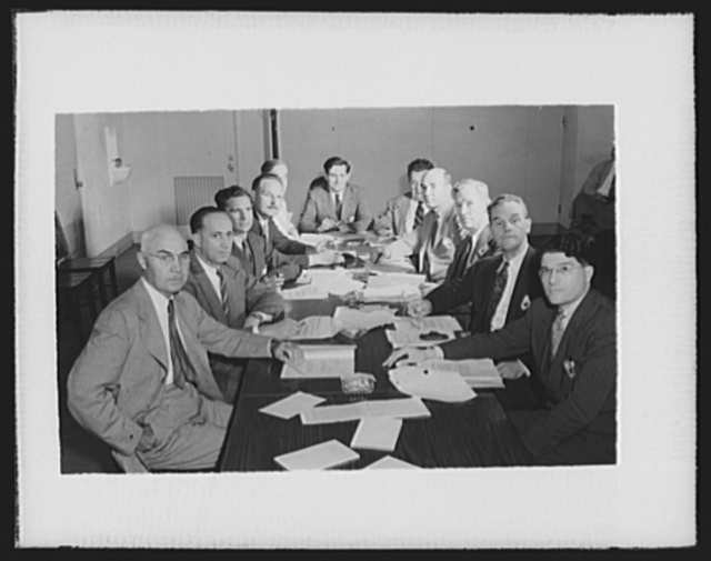 War production drive committee of technical experts. The war production drive's technical committee of experts, established to pass on war production suggestions for which Certificates of Individual Production Merit and Citations of Individual Production Merit will be awarded. Left to right: John L. Savage, Chief Designing Engineer, U.S. Bureau of Reclamation, Denver, Colorado; Dr. Robert F. Blanks, Chief of Testing Laboratories, Bureau of Reclamation, Denver, Colorado; William Plumer Hill, Sparrows Point, Maryland; Paul H. Stanley, Willow Grove, Pennsylvania; Whiting Williams, Cleveland, Ohio; William E. Warne, Assistant Chief, War Production Drive Headquarters; Ray Millholland, Chief, Technical Section, War Production Drive Headquarters; Henry C. Atkins, Jr., Indianapolis, Indiana; Charles B. Francis, Pittsburgh, Pennsylvania; Dr. J. L. Bray, Purdue University, Indiana, and Dr. Joseph Rockoff, Dayton, Ohio. The first awards, announced today, September 8, 1942, were for Certificates of Individual Production Merit to sixteen men and one woman. The Committee also established another classification: honorable mention, which was awarded to sixteen other men