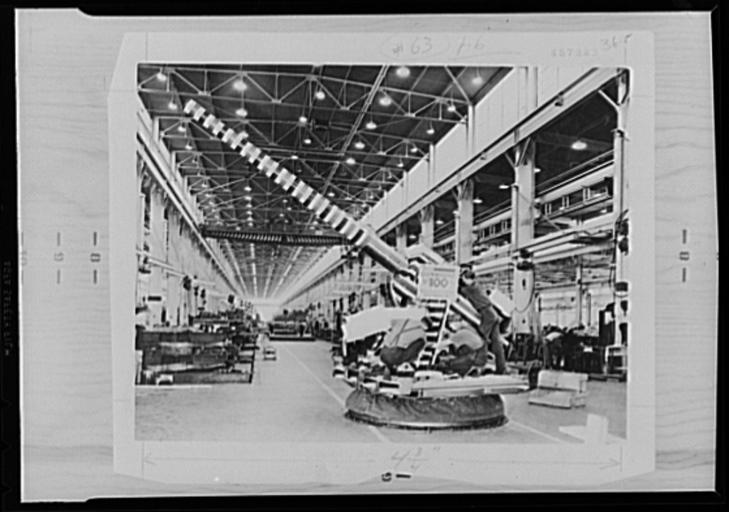 War production drive. It was a great day in the plant of the Northern Pump Company, Minneapolis, when the 100th gun mount was completed. It was decorated with a dummy barrel and festooned in red, white, and blue. Employees staged an impromptu celebration. Many more units have been produced since then and the labor-management committee has been credited with stepping up the rate of production