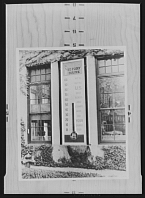 War production drive. This huge thermometer outside a Westinghouse plant recorded the workers' purchase of bonds and stamps. Labor-management committees have reported that it is good psychology to display devices like this because both employers and employees are eager to show the public how good they are