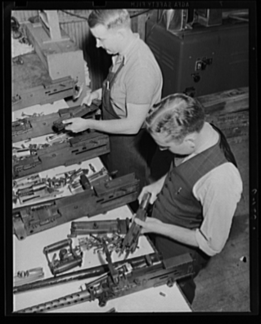 War program keeps its eye on the ballistics. These 50 caliber machine guns are being inspected in the ballistics laboratory at an eastern armory