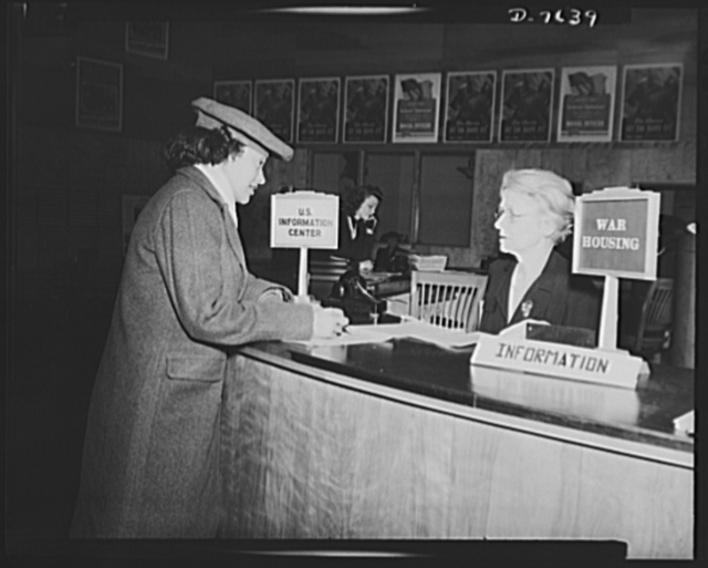 War worker goes to Washington. Acting on the advice of the personnel advisor in her section of the War Department, Miss Clara Camille Carroll registers at the War Housing desk at the United States Informational Service, Fourteenth Street and Pennsylvania Avenue, North West. This office was established to aid war workers in obtaining suitable living quarters