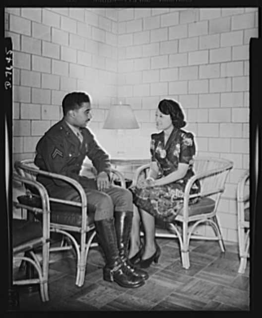 War worker goes to Washington. Back home in the Lucy D. Slowe Resident Hall, Miss Clara Camille Carroll meets a Cleveland, Ohio, friend, Corporal William M. Decatur, Jr., of the cavalry detachment at Fort Meyer, Virginia. While a party for service men is being held in the recreation room, the two home-towners retire to the lounge to discuss old times