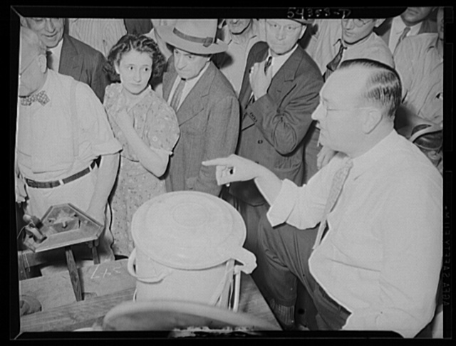 Washington, D.C. A crowd listening to an auctioneer at the Adam A. Weschler & Son store