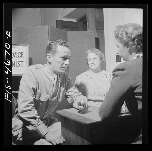 Washington, D.C. A soldier asking for help for his mother at the Red Cross home service office. This service deals with personal problems of servicemen, acts as a liaison between them and their families at home and often helps them out with loans or grants of money