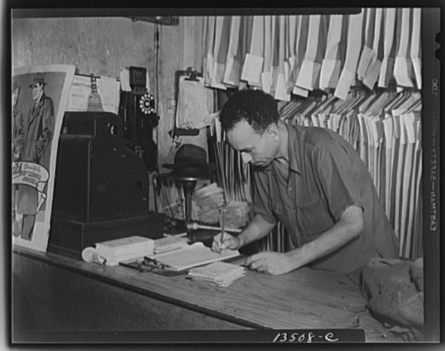 Washington, D.C. A tailor in Frank's cleaning and pressing establishment checking over the days intake