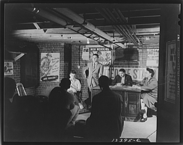 Washington, D.C. Air raid wardens' meeting in zone nine, Southwest area. Elmer House, federal worker by day and an air raid warden at night, outlining plans for his sector