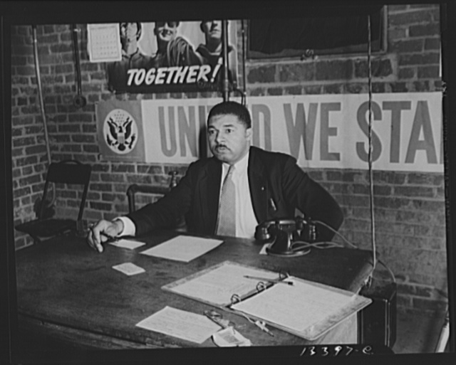 Washington, D.C. Air raid wardens' meeting in zone nine, Southwest area. Mr. Douglas Frederick, who is a firewatcher at the hotel where he is employed and a deputy warden in his neighborhood, presiding at a meeting of the wardens