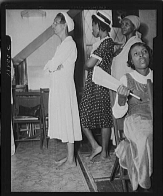 """Washington, D.C. As in Moses' time, members of the St. Martins Spiritual Church remove their shoes during the annual """"flower bowl demonstration"""" because during this service they walk on holy ground"""