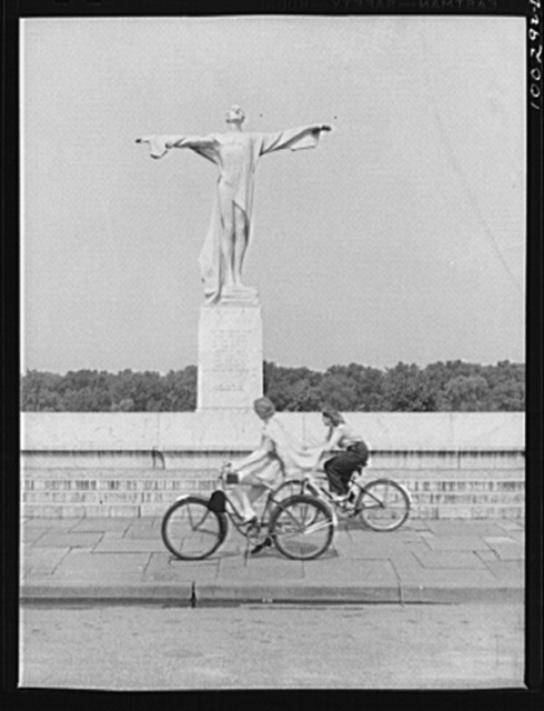 Washington, D.C. Bicycling on Sunday in East Potomac Park, in front of the statue erected to the memory of the victims of the Titanic