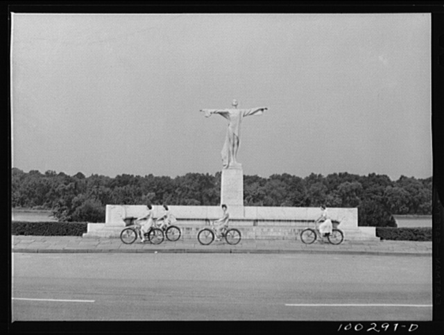 Washington, D.C. Bicycling on Sunday in East Potomac Park, in front of the statue erected to the memory of the victims of the Titanic disaster