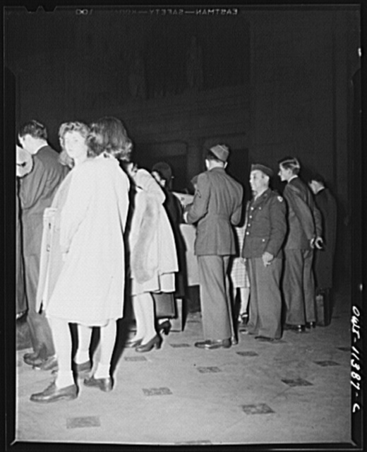 Washington, D.C. Civilians and soldiers at the ticket window at the Union Station