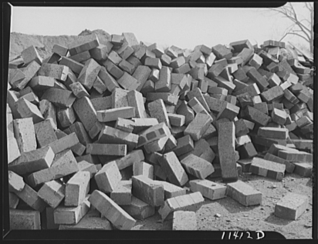 Washington, D.C. Construction of temporary war emergency buildings on the Mall, near 16th and 17th Streets, N.W. Pile of bricks