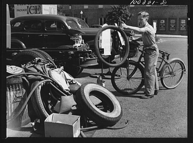 Washington, D.C. Cyclist contributes to rubber salvage pile at Georgia Avenue