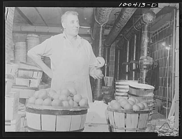 Washington, D.C. District grocery store warehouse on 4th Street S.W. This man is a sorter. He grades fruits and vegetables and throws out spoiled ones
