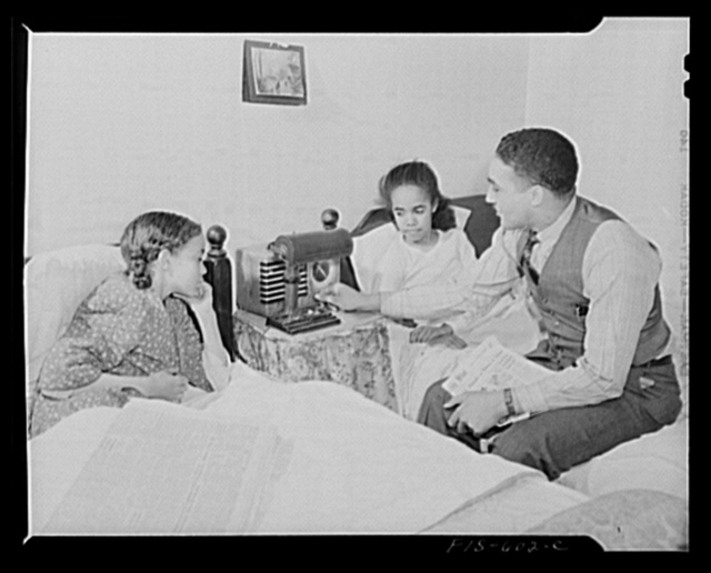 Washington, D.C. Dr. Mazique with two of their nieces whom he and his wife, Jewal Mazique [i.e. Jewel], a worker at the Library of Congress, are rearing