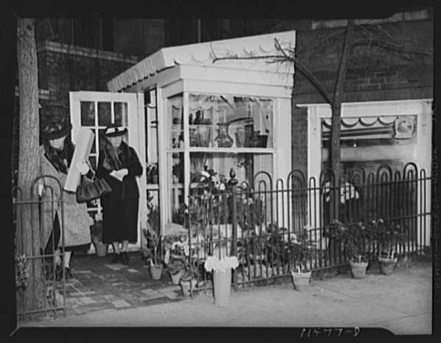 Washington, D.C. Florist's shop on Dupont Circle with a lady carrying a box of flowers