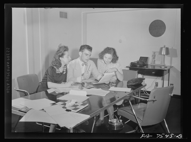 Washington, D.C. Foreign students at the international student assembly recording short talks in their native language to be broadcast by shortwave, after censorship by the Office of War Information (OWI), to Nazi-held territory. French group preparing speeches for broadcast. Left to right Doris Koren, Lucky Baum, Francoise Benoit Levy