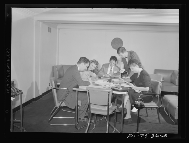 Washington, D.C. Foreign students at the international student assembly recording short talks in their native language to be broadcast by shortwave, after censorship by the OWI (Office of War Information), to Nazi-held territory. Mr. House of OWI checking speeches before recording. Left to right: an officer of the Inter-American news office, Mr. House Enrigue Avila of Peru, Evelyn Rains of Chile and Dr. Penton of Cuba