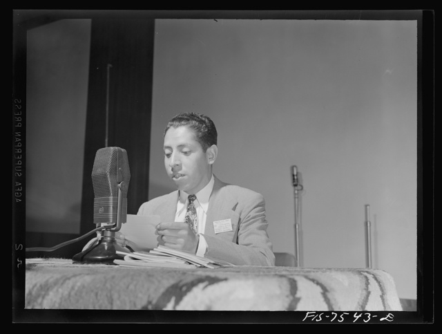 Washington, D.C. Foreign students at the international student assembly recording short talks in their native language to be broadcast by short wave, after censorship by the Office of War Information (OWI), to Nazi-held territory. Enrigue Avila of Peru