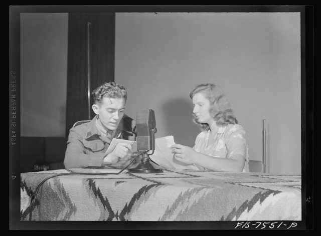 Washington, D.C. Foreign students at the international student assembly recording short talks in their native language, to be broadcast by shortwave, after censorship by the Office of War Information (OWI), to Nazi-held territory. Yolande Dankowier and Corporal Dziedzioch of Poland checking over their talks before recording