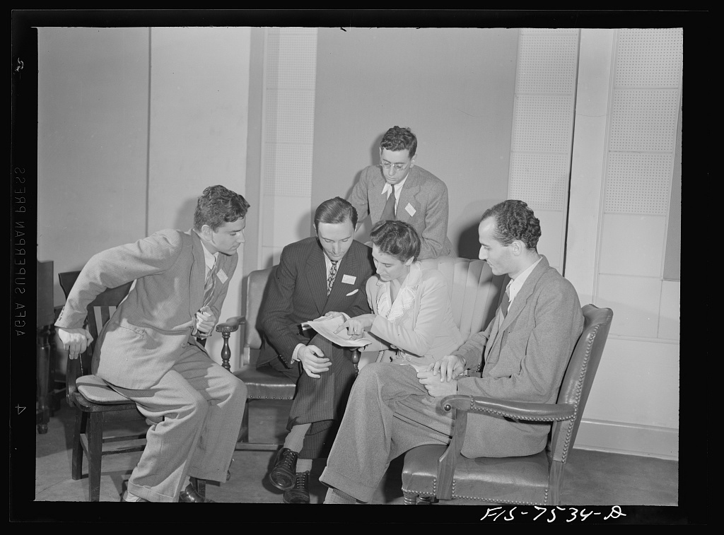 Washington, D.C. Foreign students at the international student sssembly recording short talks in their native language to be broadcast by shortwave, after censorship by the Office of War Information (OWI), to Nazi-held territory. An Italian group discussing the wording of their speeches