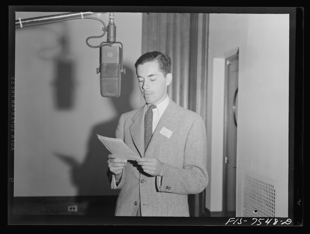 Washington, D.C. Foreign students at the international student sssembly recording short talks in their native language to be broadcast by shortwave, after censorship by the Office of War Information (OWI), to Nazi-held territory. Hernando Groot of Colombia
