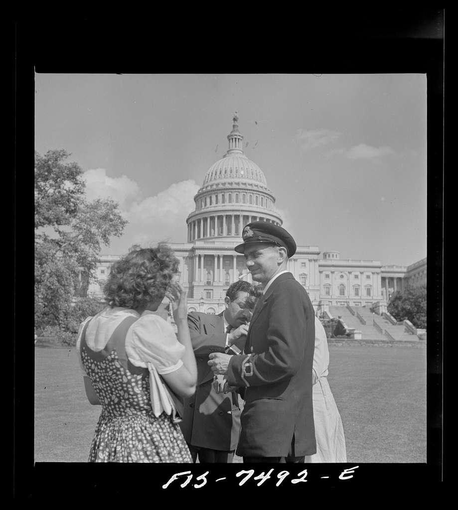 Washington, D.C. International student assembly. Diana Mowrer, of the U.S.; Abd El Hamid Zaki, of Egypt; and Sub Lieutenant Richard Miles of Great Britain on the Capitol