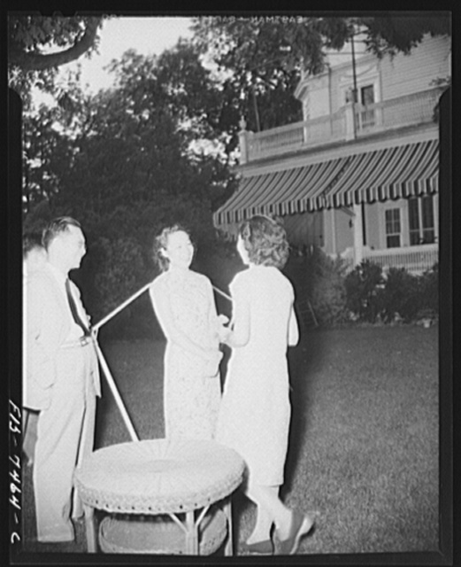 Washington, D.C. International student assembly. Mr. and Mrs. C.W. Yin (second secretary to the Chinese embassy) greeting student in the garden of the Chinese embassy