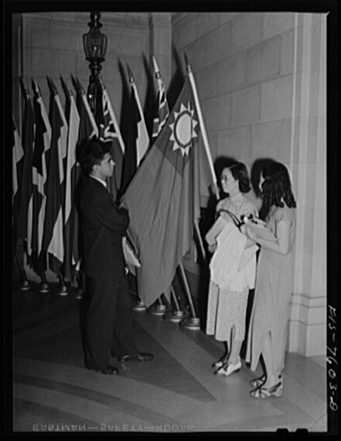 Washington, D.C. International youth assembly. An American student discussing the Chinese flag with two Chinese delegates