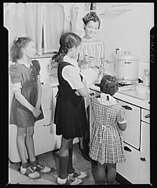 Washington, D.C. Jewal Mazique [i.e. Jewel], worker at the Library of Congress, cooking dinner for her husband and her three nieces whom she is raising and educating