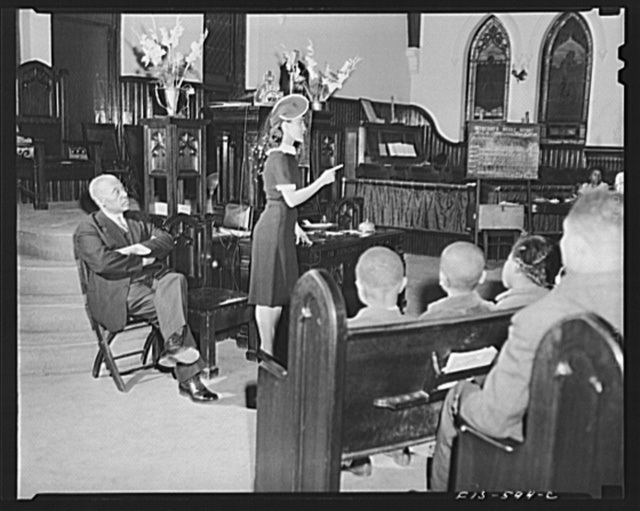 Washington, D.C. Jewal Mazique [i.e. Jewel], worker at the Library of Congress, lecturing at church on the Negro participation in the war effort