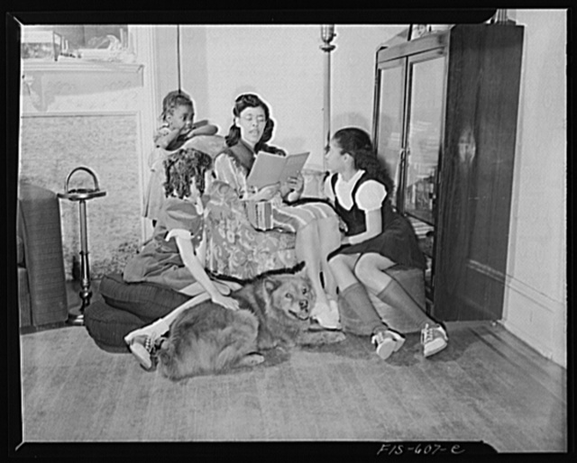 Washington, D.C. Jewal Mazique [i.e. Jewel], worker at the Library of Congress, reading to her young nieces