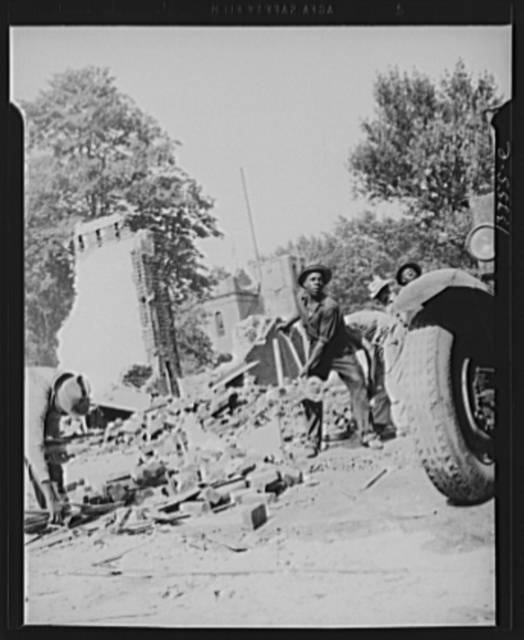 Washington, D.C. Loading debris from wrecked buildings along Independence Avenue