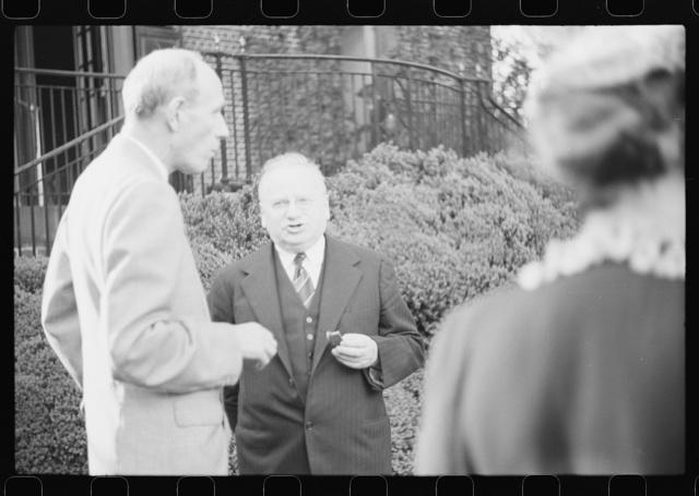Washington, D.C. Lord Halifax, British ambassador, chatting with Maxim Litvinoff, Russian ambassador, at a garden party at the New Zealand Legation