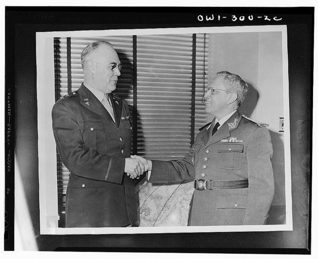 Washington, D.C. Major General James C. Magee, Surgeon General of the U.S. Army, greeting Surgeon General J.A. de Souza Ferreira, of the Brazilian army, who flew to Washington for conference